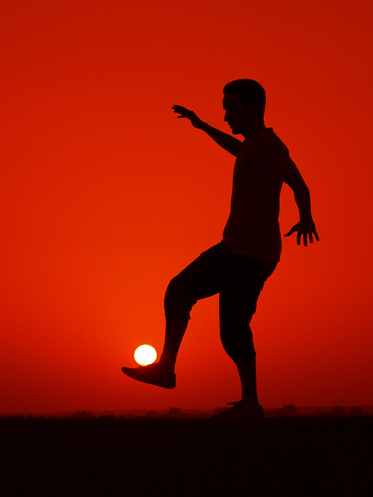playing-football-with-sun-perfect-timing-photo